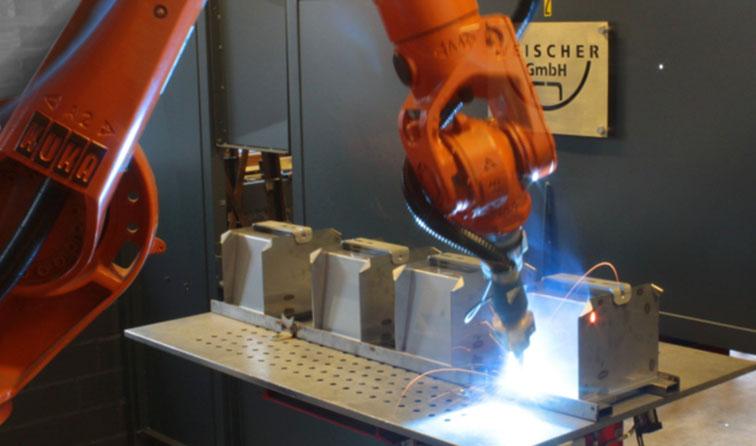 Inbetriebnahme einer Schweißzelle mit KUKA Schweißroboter und Lorch Schweißanlage